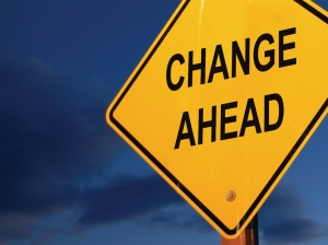Road sign depicting change ahead